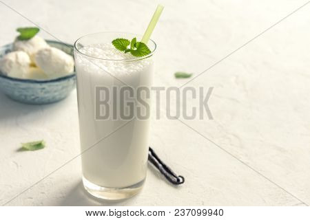 Vanilla Shake With Ice Cream And Mint On White Background. Vanilla Ice Cream Milk Shake. Banana Smoo
