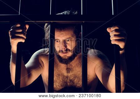 An angry man in a jail