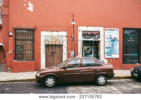Merida / Yucatan, Mexico - May 31, 2015: The Brown Car Parking Infront Of The House With  Pastel Bro