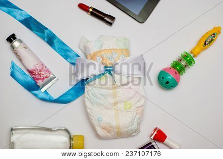 Contents Of A Woman's Bag On White Background.