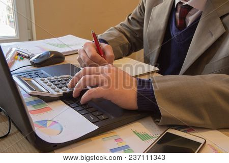 Businessman Using A Calculator To Calculate The Numbers. Businessman Calculate Finance And Thinking
