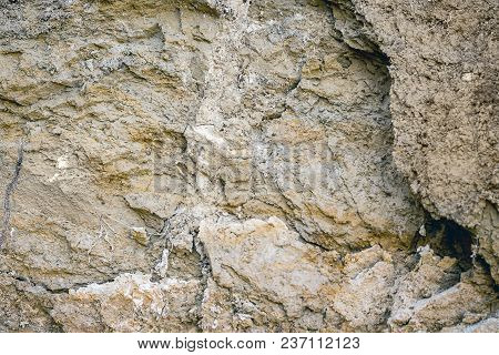 Texture Of  Clayey Earth Surface With Layers Of Solid