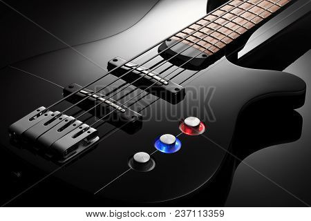 Close Up On The Body Of Elegant Black Bass Guitar, Black Glossy Background