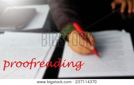 Red Proofreading Word Over Blur Hand Checking Document In Office