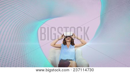Surprised woman in VR headset looking at lights against pink background