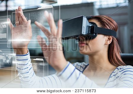 Woman in VR headset touching interfaces