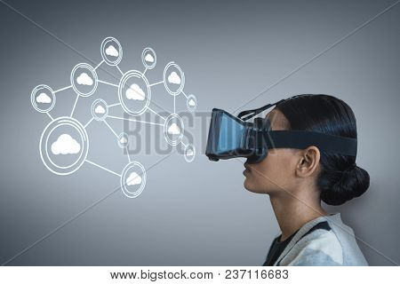 Woman in VR headset looking at interface against purple background