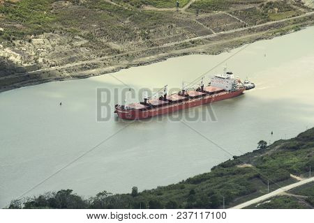Tugboat Assisting Tanker Carrier In The Panama Canal
