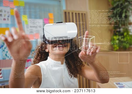 Happy woman in VR headset touching interface