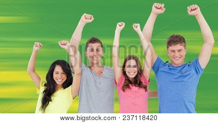 Millennials celebrating against blurry green and yellow background