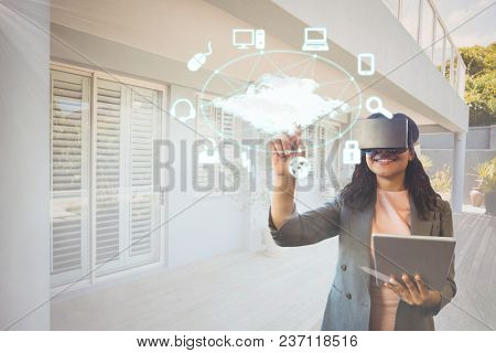 Happy woman in VR headset interacting with interface