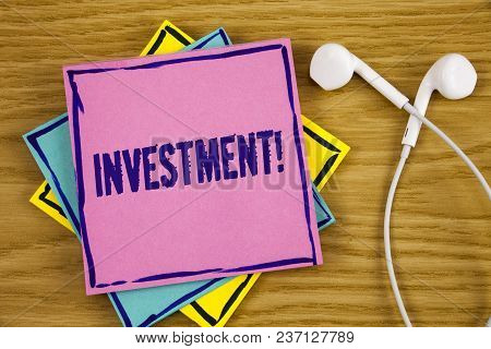 Conceptual Hand Writing Showing Investment Motivational Call. Business Photo Showcasing To Put Money