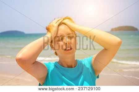 Woman On Hot Beach With Sunstroke. Health Problem On Holiday. Medicine On Vacation. Dangerous Sun. B