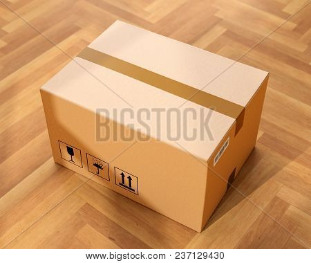 Cardboard Box On Wood Floor In Front Of Entrance Door. Doorstep Parcel Delivery, Free Shipping, And