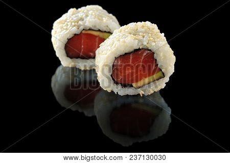 Fresh Made Sushi Rolls On Black Reflective Background.