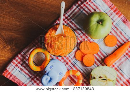 Baby Food Carrot Puree With Green Apples In Ceramic Bowl
