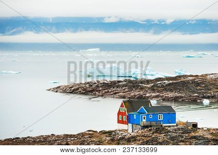 Colorful Houses On The Shore Of Atlantic Ocean. Saqqaq Village, Western Greenland