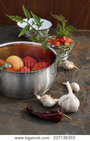 Fresh Tomatoes And Pepper In Pot. Colorful Image With Assorted Colorful Tomatoes, Different Pepper,