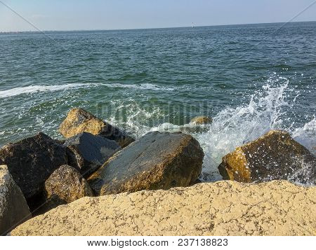 Water Splash At A Rock On The Beach In Summer