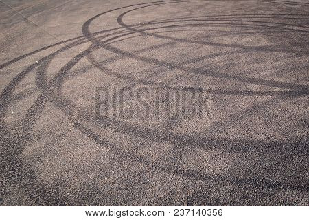 Urban Background With Tire Tracks On The Asphalt. Tone Dimage. Abstract Road Backdrop With Tyre Mark