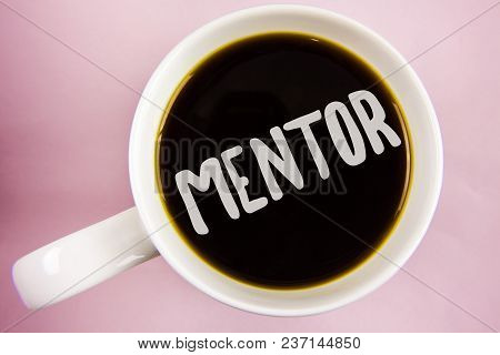Handwriting Text Writing Mentor. Concept Meaning Person Who Gives Advice Or Support To A Younger Les