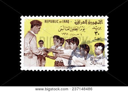 Iraq - Circa 1961 : Cancelled Postage Stamp, Printed By Iraq, That Shows General Kassem And Children