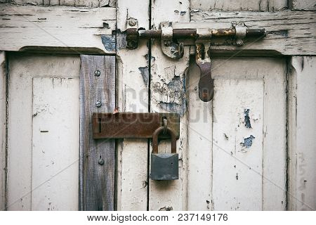 The Old Aged White Wooden Door With Latch Locking With The Rustic Key Lock On The Hinge