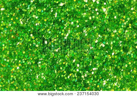 Green Glitter Texture On Macro. High Resolution Photo.