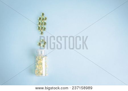 Pills Yellow Laid Out In The Form Of An Exclamation Point On The Blue Pastel Background With Copy Sp