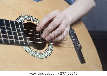 Young Woman's Hands Playing A Acoustic Classic Guitar