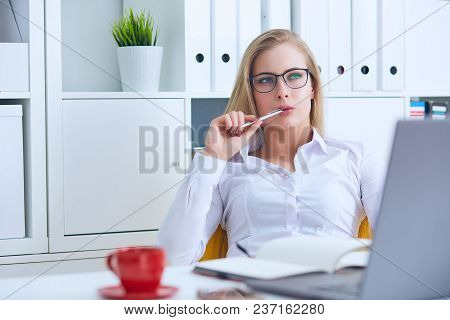 Thoughtful Woman Bored At Work, Looking Away Sitting Near Laptop, Demotivated Office Worker Feels La