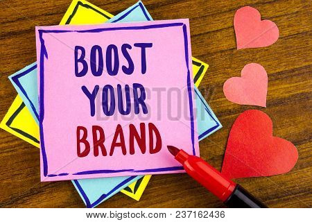 Conceptual Hand Writing Showing Boost Your Brand. Business Photo Text Improve Your Models Name In Yo