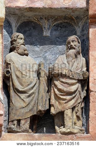 ZAGREB, CROATIA - AUGUST 23: Statues of saints on the south portal of the church of St. Mark in Zagreb, Croatia on August 23, 2017.
