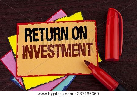Conceptual Hand Writing Showing Return On Investment. Business Photo Showcasing Performance Measure