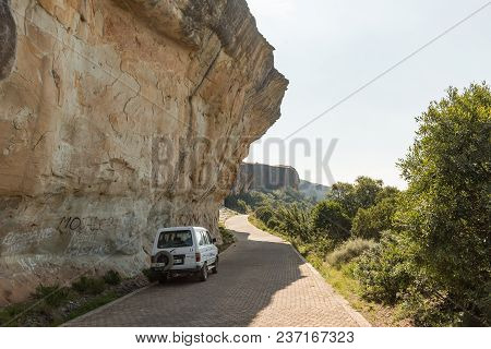 Witsieshoek, South Africa - March 13, 2018: An Overhanging Sandstone Cliff Next To The Road To The W