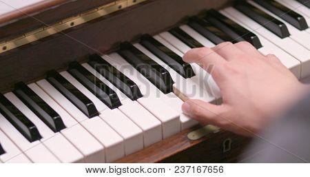 Man practicing piano at home