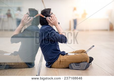 Reflection Of Young Asian Business Man Enjoy Listening To Music By Headphones While Using Laptop Com