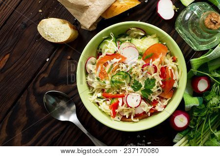 Summer Vitamin Salad With Fresh Vegetables Dressing Olive Oil. The Concept Of Healthy And Dietary Nu