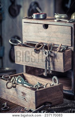 Wooden Box With Tools, Locks And Keys In Locksmiths Workshop