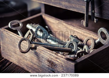 Old Keys In Wooden Box In Locksmiths Workshop