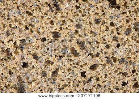 The Rye Brown Or Black Bread Background Or Texture. The Macro Shot Is Made By Means Of Stacking Tech