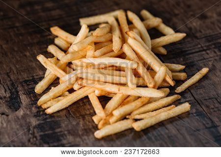 French Fries Potatoes On Dark Wood Background