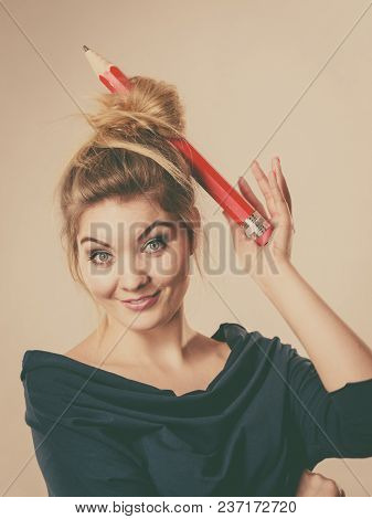 Charming Happy Blonde Woman Having Big Pencil In Hair Having Fun, Education Ideas.