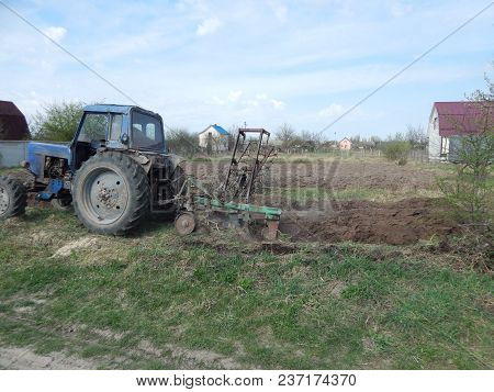 Tractor Plows The Land On The Land