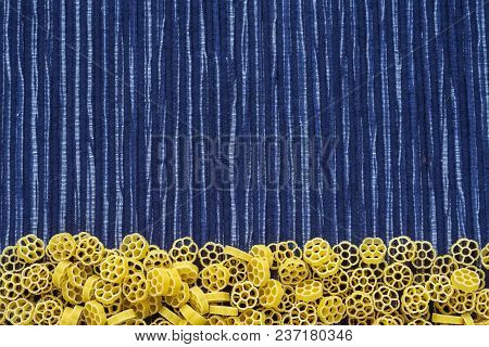 Raw Ruote Beautiful Decomposed Pasta With A Bottom On A Rustic Striped Blue White Textured Backgroun