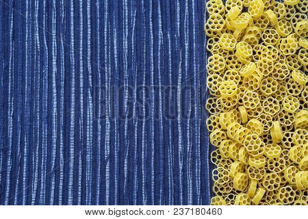 Raw Ruote Beautiful Decomposed Pasta With The Right, On Its Side In A Rustic Striped Blue Against A