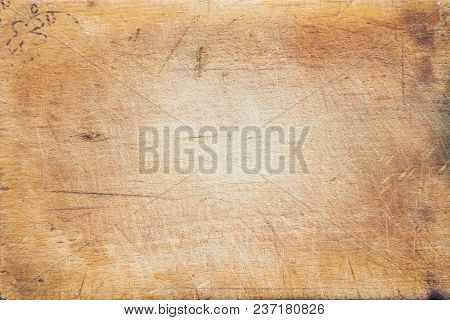A Textured Wooden Cutting Board. Close-up View From The Top. Free Space For Text.