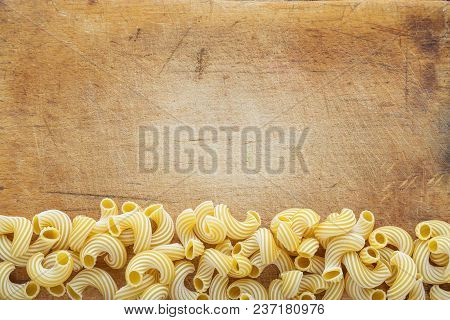 Raw Cavatappi Beautiful Decomposed Pasta With A Bottom On A Wooden Plank Texture Background. Close-u