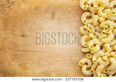 Raw Cavatappi Beautiful Laid Out Pasta With The Right, Side On A Wooden Plank Texture Background. Cl