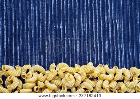 Raw Cavatappi Beautiful Decomposed Pasta With A Bottom On A Rustic Striped Blue White Textured Backg